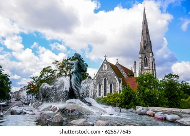 COPENHAGEN, DENMARK - JULY 20: Gefion Fountain and St. Alban's Church, a large fountain on harbor front and the most popular tourist destination in Copenhagen, Denmark
