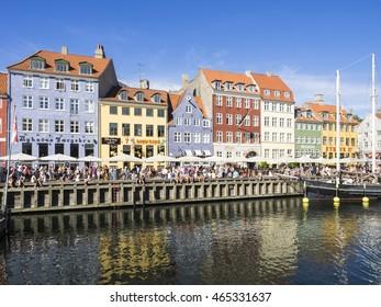 COPENHAGEN, DENMARK - JULY 21, 2016: Colorful buildings of Nyhavn in a sunny summer day