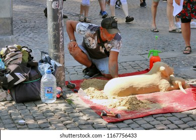 COPENHAGEN, DENMARK - JULY 21: This street performer sells his artistic creativity from sand and watter in downtown Copenhagen, Denmark on July 21, 2018