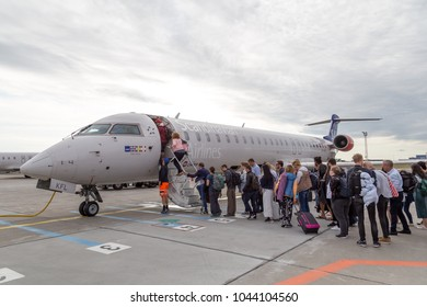 Copenhagen, Denmark - July 22, 2017: People boarding a SAS airplane at Copenhagen airport