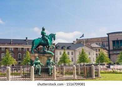 Copenhagen, Denmark - July 26 2019: The statue of King Christian V of Denmark in Kongens Nytorv ( Kings Square ), Copenhagen city centre, Denmark