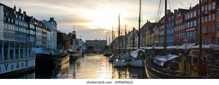 Copenhagen, Denmark - July 27, 2017: 17th-century waterfront Nyhavn (New Harbour), new port of Copenhagen. Colorful panorama of old town architecture. Copenhagen boats, European street