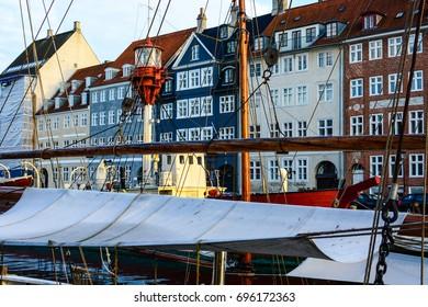 Copenhagen, Denmark - July 27, 2017: Nyhavn (New Harbour), new port of Copenhagen. Colorful old town architecture. Copenhagen boats, European street