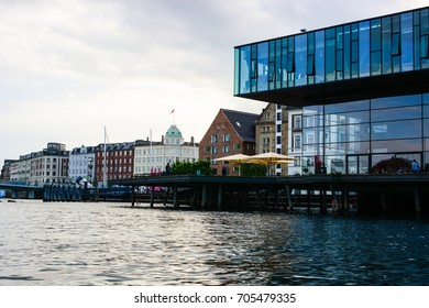 Copenhagen, Denmark - July 27, 2017: The Royal Danish Playhouse and Copenhagen cityscape. Old and modern architecture on a canal bank, panoramic view of European city