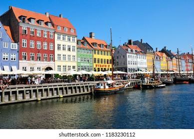 Copenhagen, Denmark - July 27, 2018 - Colourful facades along Nyhavn in Copenhagen