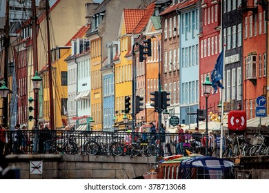 Copenhagen, Denmark - July 29, 2015: People are walking in Nyhavn, a 17th-century waterfront and entertainment district with brightly coloured townhouses, bars, cafes and restaurants.