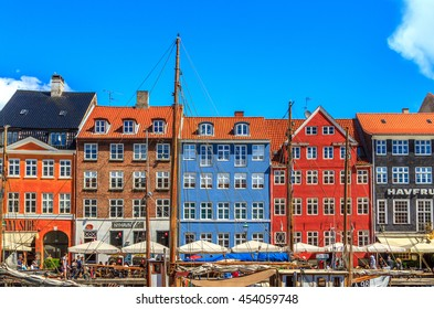 COPENHAGEN, DENMARK - JULY 3, 2016: Nyhavn a 17th century harbour in Copenhagen with typical colorful houses and water canals, Nyhavn, Copenhagen, Denmark