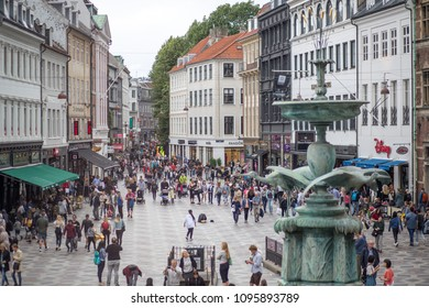 Copenhagen, Denmark - July 30, 2017: People on main pedestrian and shopping street called Stroget in historic city centre