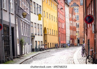 Copenhagen, Denmark - July 30, 2017: Colorful houses in Magstraede, one of the oldest roads in the historic city center