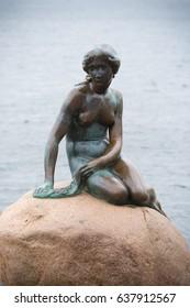 COPENHAGEN, DENMARK - JULY 31, 2016: The Little Mermaid (Danish: Den lille Havfrue) is a bronze statue by Edvard Eriksen, depicting a mermaid.