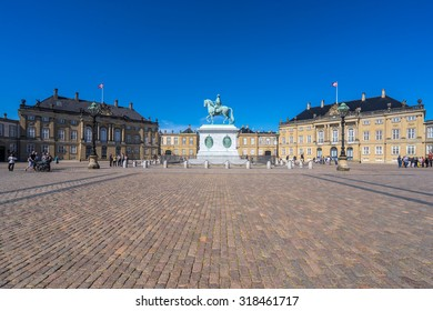 COPENHAGEN, DENMARK - JUNE 05, 2015: People visit the Amelienborg Palace in the Danish capital city Copenhagen. It is a residence of the Danish royal family.