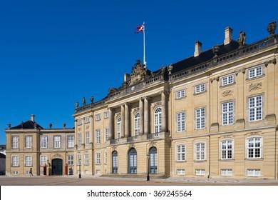 COPENHAGEN, DENMARK - JUNE 05, 2015: Guard walks in front of the Amelienborg Palace in the Danish capital city Copenhagen. It is a residence of the Danish royal family.