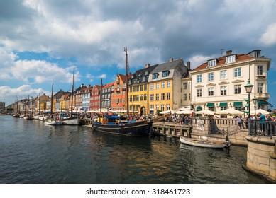 COPENHAGEN, DENMARK - JUNE 06, 2015: People enjoy a sunny day in the Nyhavn district in the Danish capital city, Copenhagen.