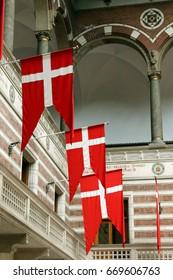 COPENHAGEN, DENMARK - JUNE, 14, 2017: The flag of Denmark (Dannebrog). City Hall Tower.