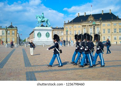 COPENHAGEN, DENMARK - JUNE 14, 2018: Danish Royal Guard marching at square by Amalienborg Palace and Frederic monument