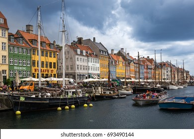 Copenhagen, Denmark - June 16, 2017: Nyhavn Pier with color Buildings and Ships, Europe