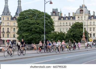 Copenhagen, Denmark - June 19, 2017: A group of cyclists in the city centre during rush hour