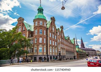 COPENHAGEN, DENMARK - June 2018: Cityscape of Copenhagen, Børsen, also known as Børsbygningen, 17th-century stock exchange in the center of Copenhagen, Denmark