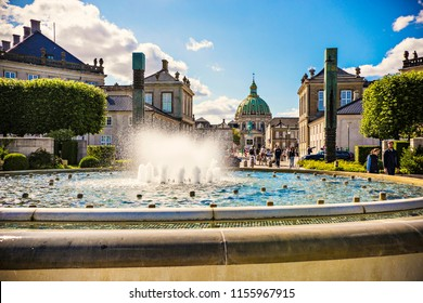 Copenhagen, Denmark - June 2018: Fountain in front of Amalienborg Palace, Denmark