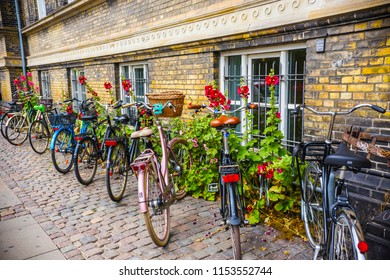 COPENHAGEN, DENMARK - June 2018: Numerous bicycles parked on the street in the center of Copenhagen, denmark