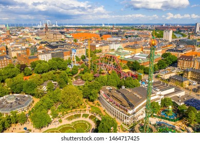 COPENHAGEN, DENMARK - JUNE 2019 - Aerial view of the Tivoli Gardens amusement park with people, visitors, attractions and rides. Urban view of the city of Copenhagen in Denmark, Europe