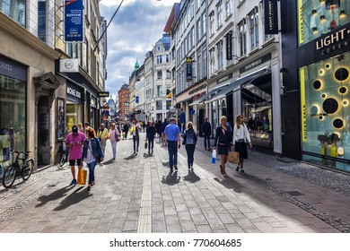 COPENHAGEN, DENMARK - JUNE 21, 2017: Scenic view of Stroget. Stroget - the main pedestrian shopping street in Copenhagen.