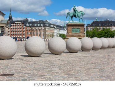 COPENHAGEN, DENMARK - JUNE 22, 2019 :Equestrian statue of King Frederick VII in front of Christiansborg, decorative stone balls