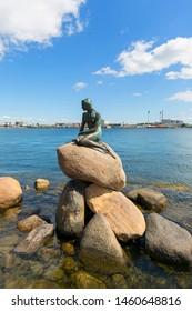 COPENHAGEN, DENMARK - JUNE 22, 2019 : The Little Mermaid, bronze statue ,character from the fairy tale Hans Christian Andersen, the symbol of Copenhagen
