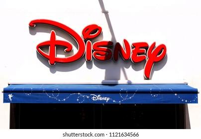 Copenhagen, Denmark - June 26, 2018: The Disney logo on sign panel at the exterior of the Disney store