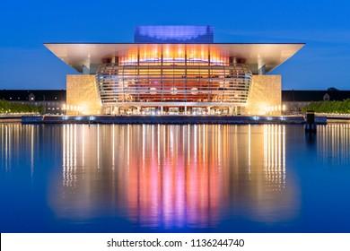 Copenhagen, Denmark - June 27, 2018: The Royal Danish Opera House at night. It was designed by Danish architect Henning Larsen.