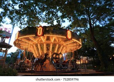 Copenhagen, Denmark - June 29, 2014: Classic Carousel in Tivoli amusement park. Almost 4 million people visit Tivoli Gardens each year.