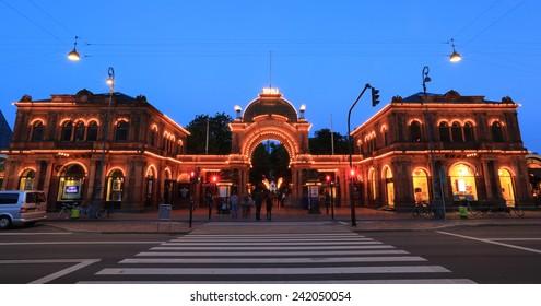 Copenhagen, Denmark - June 30, 2014: The historic main entrance of Tivoli Gardens. Opened on 15 August 1843, Tivoli gardens is the second oldest amusement park in the world.