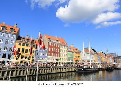 Copenhagen, Denmark - June 30, 2014: Visitors strolling in Nyhavn Canal, Copenhagen, Denmark