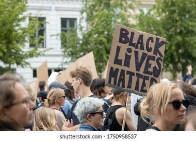 Copenhagen, Denmark - June 7th 2020: Cardboard sign saying 'Black lives matter' outside the American embassy, at demonstration arranged by Black Lives Matter Denmark