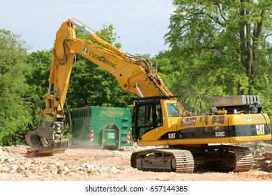 COPENHAGEN, DENMARK - JUNE, 9, 2017: Yellow Cat 330C hydraulic excavator.