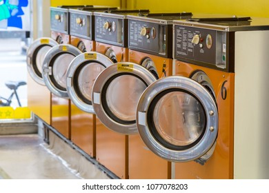 Copenhagen, Denmark - March 07, 2017: Row of washing machines in a laundromat