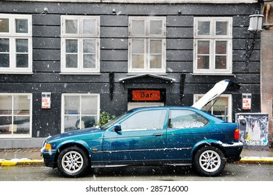 COPENHAGEN, DENMARK - MARCH 13: Car parked on the street of Copenhagen old town on March 13, 2013. Copenhagen is the capital and largest city of Denmark.
