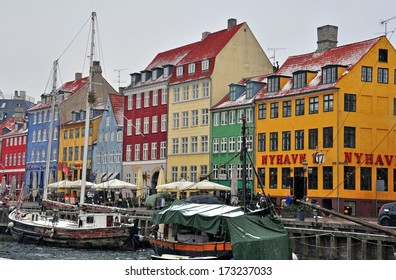 COPENHAGEN, DENMARK - MARCH 13: Multicolor houses of Nyhavn street in downtown of Copenhagen on March 13, 2013. Copenhagen is a capital and the largest city of Denmark.