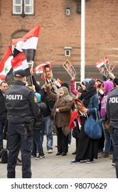 COPENHAGEN, DENMARK - MARCH 18: Happy women cheer at meeting for support Bashar al-Assad politic in Syria on City Hall Square on March 18, 2012 in Copenhagen, Denmark