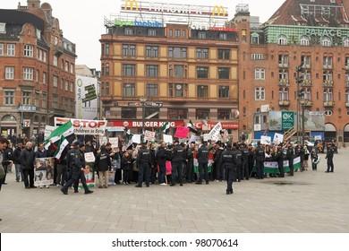 COPENHAGEN, DENMARK - MARCH 18: People protesting against Bashar al-Assad politic in Syria on City Hall Square on March 18, 2012 in Copenhagen, Denmark