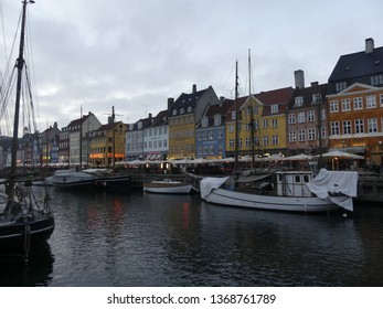 COPENHAGEN, DENMARK - MARCH 2019: View of Nyhavn. Boats stand on the Nyhavn pier in the city center.