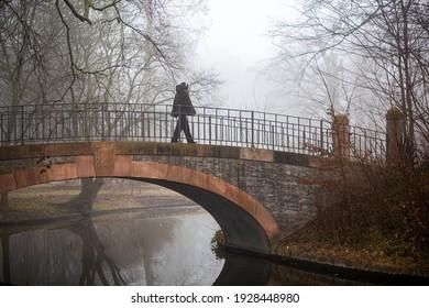 Copenhagen, Denmark - March 3, 2021: People on a foggy day in Frederiksberg Gardens.