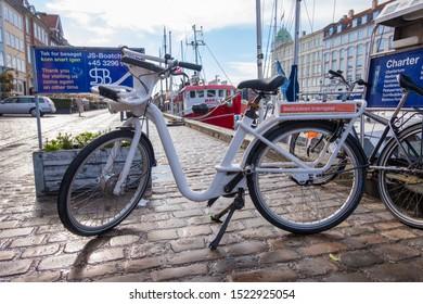 Copenhagen, Denmark - May 04, 2019: Bicycles parked on the Nyhavn embankment in Copenhagen, Denmark