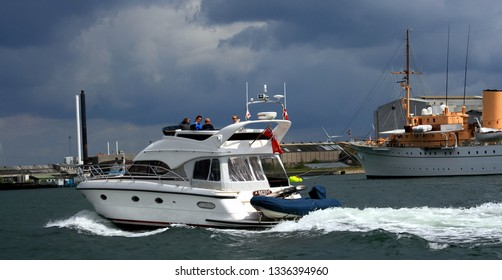 Copenhagen, Denmark - May 07 2007: People by motor yacht on canal