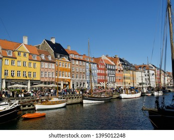 Copenhagen, Denmark. May 11 2019 - Nyhavn with colorful facades of old houses and old ships in the Old Town of Copenhagen