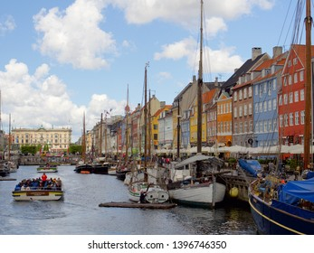 Copenhagen, Denmark. May 13 2019 - Nyhavn with colorful facades of old houses and old ships in the Old Town of Copenhagen