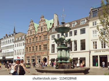 COPENHAGEN, DENMARK - MAY 16, 2018 - View of the stork fountain built in 1894 in Armagetorv in central Copenhagen with three bronze storks ready to set off