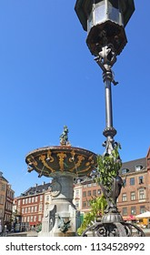 COPENHAGEN, DENMARK - MAY 16, 2018 - Caritas well fountain in Gammeltorv, the oldest fountain in Copenhagen built in 1608