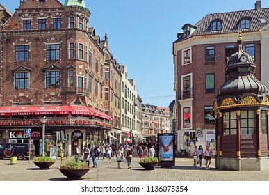 COPENHAGEN, DENMARK - MAY 16, 2018 View of Nytorv in pedestrian city center with the old baroque public telephonic kiosk, now coffee bar
