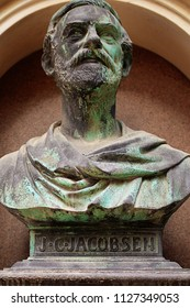 COPENHAGEN, DENMARK - MAY 18, 2018  Ny Carlsberg district: bronze bust of Jacob Christian Jacobsen danish industrialist and founder of the  Carlsberg brewery in a building facade niche.